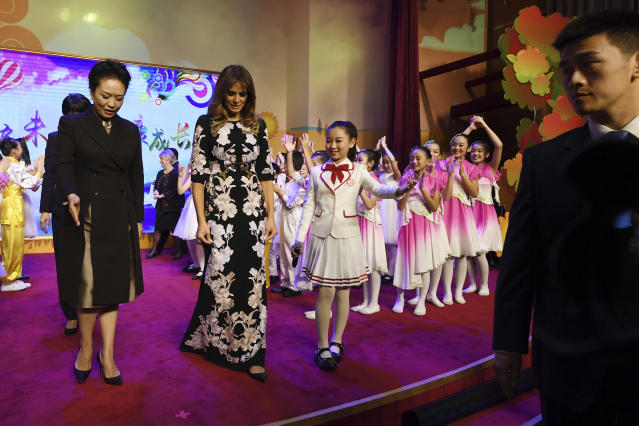First lady Melania Trump and China's first lady, Peng Liyuan, are escorted by a student after a cultural performance during a visit to the Banchang Primary School in Beijing on Nov. 9. (Photo: Greg Baker/Pool photo via AP)