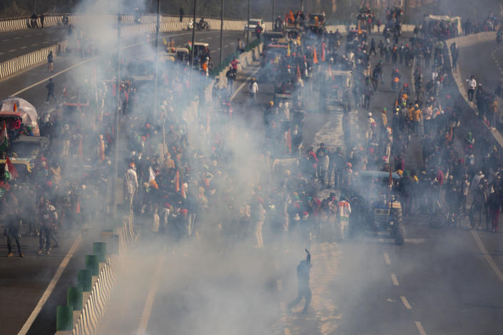 Protesting farmers are seen amid tear gas smoke fired by police in an attempt to stop them from marching to the capital during India's Republic Day celebrations in New Delhi, India, January 26, 2021. / Credit: Altaf Qadri/AP