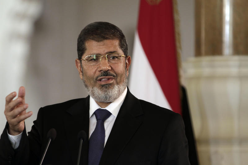 Egyptian President Mohammed Morsi speaks to reporters during a joint news conference with Tunisian President Moncef Marzouki, unseen, at the Presidential palace in Cairo, Egypt, Friday, July 13, 2012. The presidents of Egypt and Tunisia pledge to open a new chapter in relations following uprisings that overthrew longtime rulers, replacing them with a Muslim Brotherhood figure and an activist who was exiled.(AP Photo/Maya Alleruzzo)