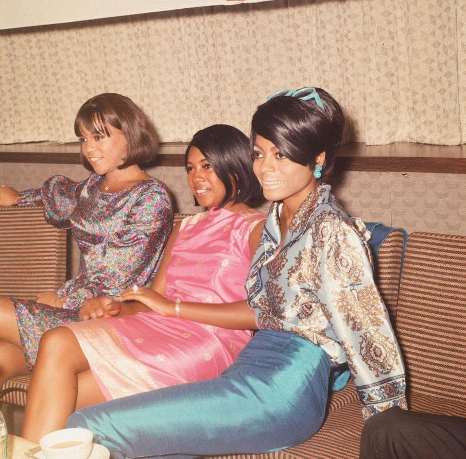 <p>In 1966, the group traveled to Japan as part of an international tour. Ross wears a bright blue crepe pencil skirt and silk blouse for the press event at their hotel in Tokyo.</p>