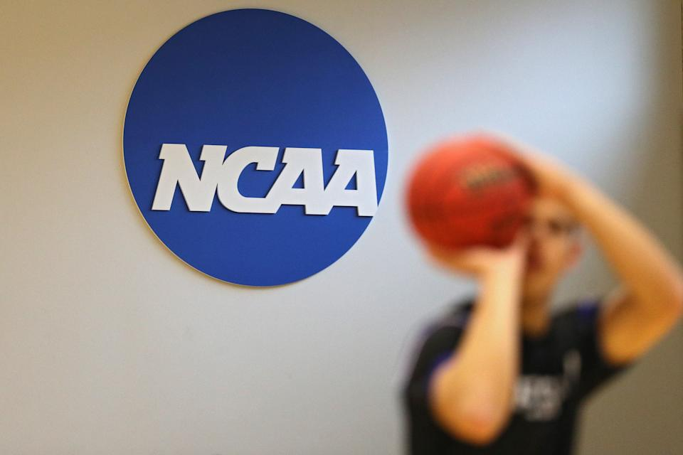 The NCAA logo is seen on the wall prior to an NCAA men's basketball game on March 6, 2020. NCAA officials are concerned about potential player prop bets in college sports. (Patrick Smith/Getty Images)