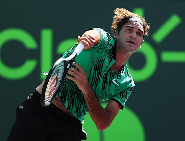 Roger Federer of Switzerland servest against Juan Martin Del Potro of Argentina during their Miami Open 3rd round match, at Crandon Park Tennis Center in Key Biscayne, Florida, on March 27, 2017 (AFP Photo/Al Bello)
