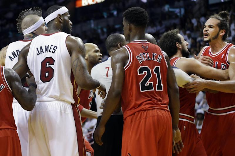 Chicago Bulls center Joakim Noah, far right, yells out after he and Miami Heat forward LeBron James (6) received technical fouls during the first half of Game 2 of their NBA basketball playoff series in the Eastern Conference semifinals, Wednesday, May 8, 2013, in Miami. (AP Photo/Lynne Sladky)