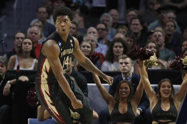 Florida State guard Terance Mann (14) celebrates after scoring against Gonzaga during the second half of an NCAA men's college basketball tournament regional semifinal Thursday, March 22, 2018, in Los Angeles. (AP Photo/Jae Hong)