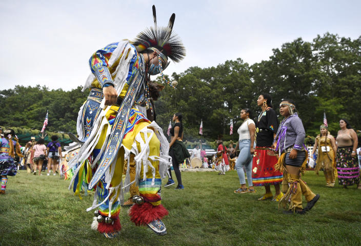 A dancer participates in an intertribal dance at Schemitzun on the Mashantucket Pequot Reservation in Mashantucket, Conn., Saturday, Aug. 28, 2021. Connecticut and a handful of other states have recently decided to mandate students be taught about Native American culture and history. (AP Photo/Jessica Hill)