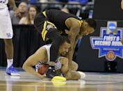 <p>Northern Kentucky forward Jeff Garrett (4), top, and Kentucky guard Isaiah Briscoe (13) fight for a loose ball during the second half of a first-round game in the men's NCAA college basketball tournament in Indianapolis, Friday, March 17, 2017. Kentucky defeated Northern Kentucky 79-70. (AP Photo/Michael Conroy) </p>