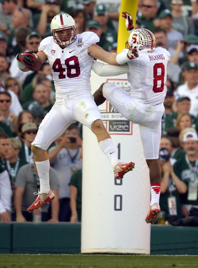 Stanford linebacker Kevin Anderson, left, celebrates a touchdown with Stanford safety Jordan Richards, against Michigan State during the first half of the Rose Bowl NCAA college football game on Wednesday, Jan. 1, 2014, in Pasadena, Calif. (AP Photo/Mark J. Terrill)