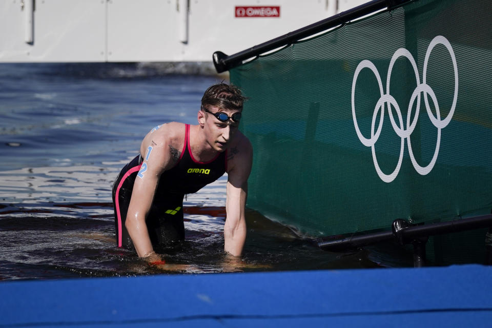 Florian Wellbrock, of Germany, crawls out of the water after winning the men's marathon swimming event at the 2020 Summer Olympics, Thursday, Aug. 5, 2021, in Tokyo, Japan. (AP Photo/Jae C. Hong)