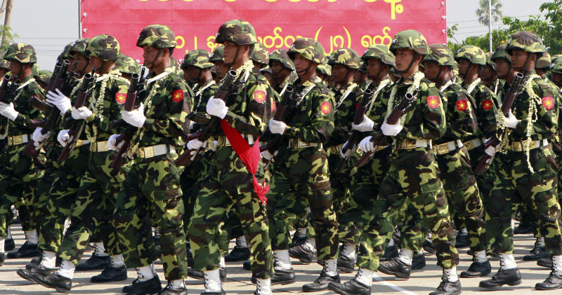 In this photo taken on March. 27, 2012, Myanmar soldiers march during a ceremony to mark the country's 67th Armed Forces Day in Naypyitaw, Myanmar. Ethnic Kachin rebels in Myanmar say clashes in the country's north are continuing despite a government promise to cease fire. An official with the Kachin Independence Army says government forces stopped attacks Saturday, Jan. 19, 2013 around an army base at Lajayang, just south of the rebel-held town of Laiza. But the official says army assaults are under way elsewhere on least three other rebel positions in the region. (AP Photo/Khin Maung Win)