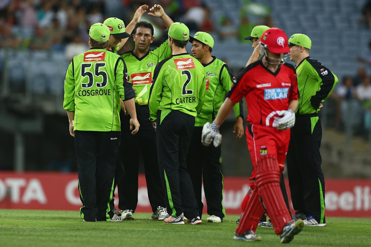 SYDNEY, AUSTRALIA - DECEMBER 14:  Azhar Mahmood of the Thunder celebrates with his team after taking the wicket of Daniel Harris of the Renegades during the Big Bash League match between the Sydney Thunder and the Melbourne Renegades at ANZ Stadium on December 14, 2012 in Sydney, Australia.  (Photo by Mark Kolbe/Getty Images)