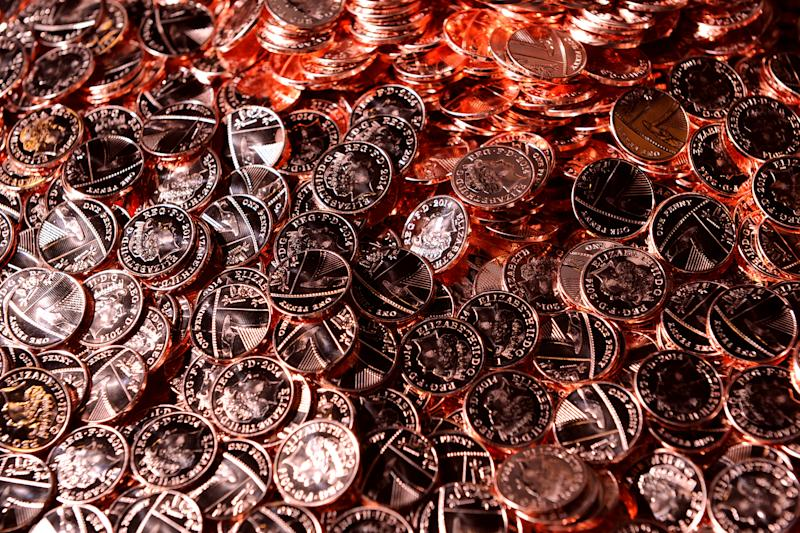 New pennies come off the production line at the Royal Mint. Photo: Joe Giddens/PA Wire