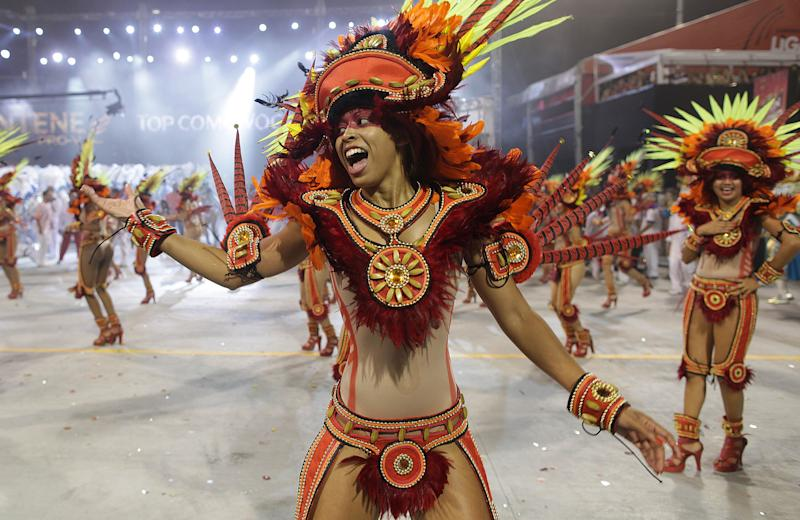 A dancer performs during a carnival parade by the Perola Negra samba school in Sao Paulo, Brazil, early Sunday Feb. 19, 2012. Carnival runs Feb. 17-21. (AP Photo/Andre Penner)