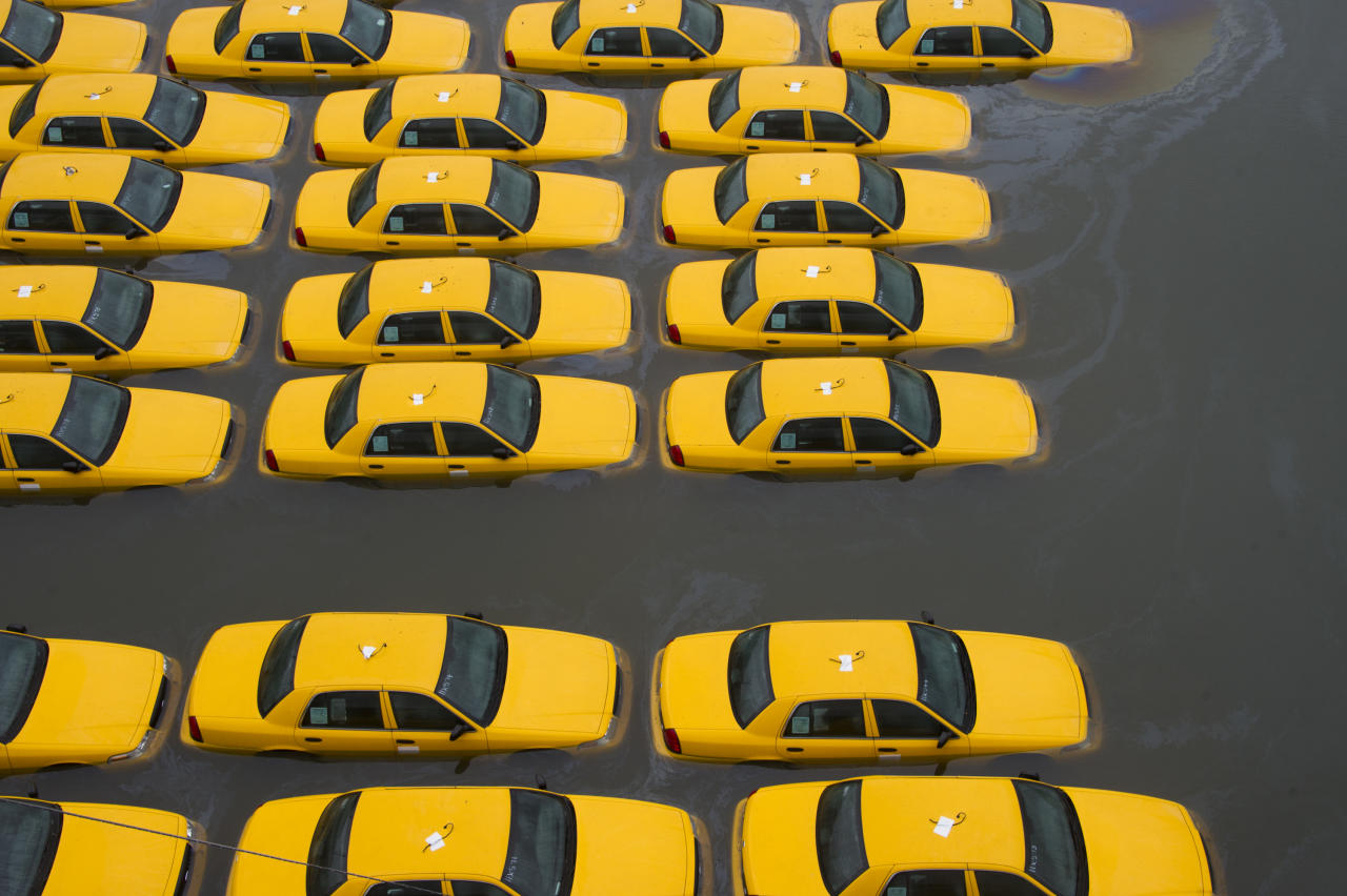 <p>               A parking lot full of yellow cabs is flooded as a result of superstorm Sandy on Tuesday, Oct. 30, 2012 in Hoboken, NJ. (AP Photo/Charles Sykes)