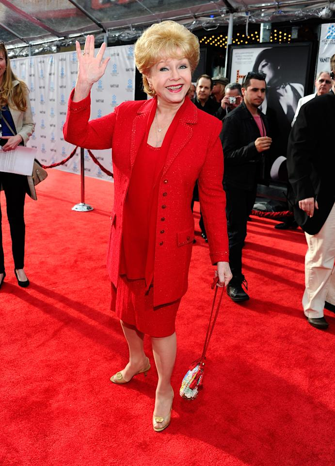 """HOLLYWOOD, CA - APRIL 12:  Actress Debbie Reynolds arrives at the TCM Classic Film Festival opening night premiere of the 40th anniversary restoration of """"Cabaret"""" at Grauman's Chinese Theatre on April 12, 2012 in Hollywood, California.  (Photo by Alberto E. Rodriguez/Getty Images)"""
