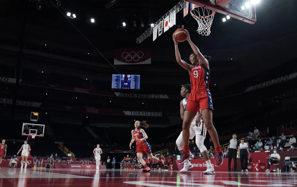 United States' A'Ja Wilson (9) pulls down a rebound during women's basketball preliminary round game against France at the 2020 Summer Olympics, Monday, Aug. 2, 2021, in Saitama, Japan. (AP Photo/Eric Gay)