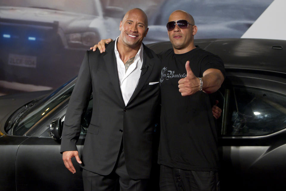 "RIO DE JANEIRO, BRAZIL - APRIL 15:   Dwayne Johnson (The Rock) and Vin Diesel (R) pose for photographers during the premiere of the movie ""Fast and Furious 5"" at Cinepolis Lagoon on April 15, 2011 in Rio de Janeiro, Brazil. (Photo by Buda Mendes/LatinContent via Getty Images)"