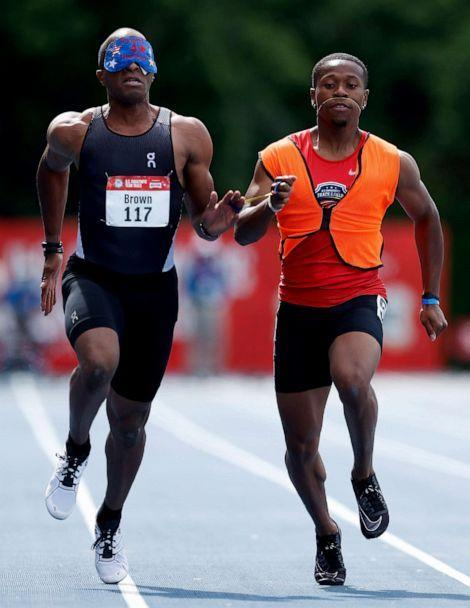 PHOTO: David Brown of the United States and guide Moray Stewart compete in the Men's 100 Meter Dash T11 Ambulatory final during the 2021 U.S. Paralympic Trials at Breck High School, June 19,  2021, in Minneapolis, Minnesota. (Christian Petersen/Getty Images)