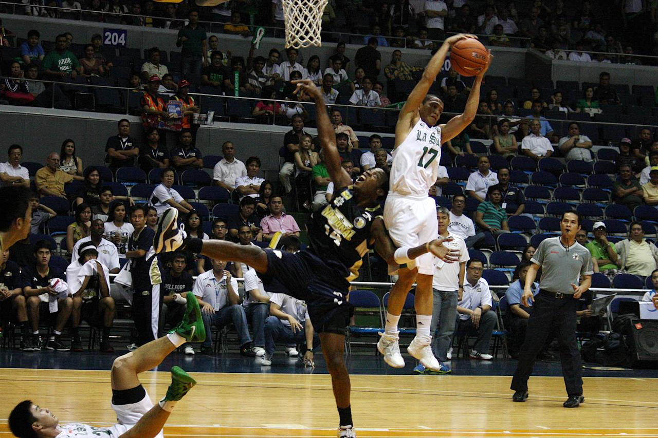 """Almond Vosotros of DLSU gets the ball during the UAAP Season 74 basketball game against NU Bulldogs at Smart Araneta Coliseum in Quezon City. <a href=""""http://ph.news.yahoo.com/sports/"""">more sports news</a>(Marlo Cueto/NPPA Images)"""