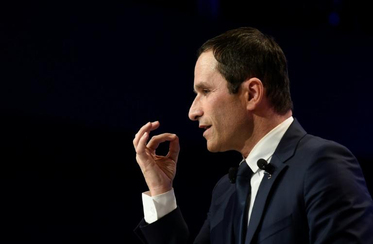 French presidential election candidate for the left-wing French Socialist (PS) party Benoit Hamon gestures as he speaks during a meeting on March 21, 2017 in Brussels