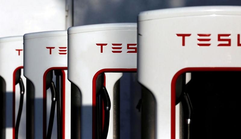 FILE PHOTO - A Tesla Supercharger station is shown in Cabazon, California