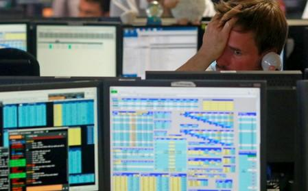 Traders from BGC, a global brokerage company in London's Canary Wharf financial centre react as European stock markets open