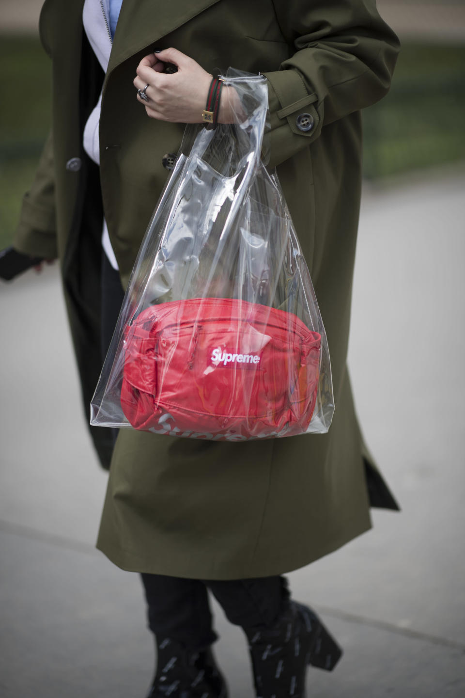 <p>Model carries red Supreme bag inside clear plastic tote. (Photo: Getty Images) </p>