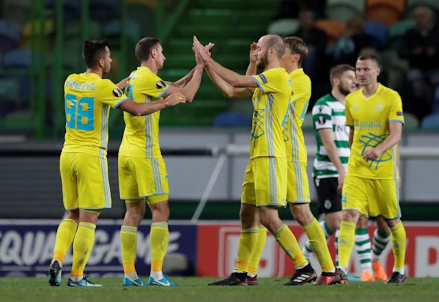 Soccer Football - Europa League Round of 32 Second Leg - Sporting CP vs Astana - Estadio Jose Alvalade, Lisbon, Portugal - February 22, 2018 Astana's Dmitri Shomko celebrates scoring their third goal with team mates REUTERS/Rafael Marchante