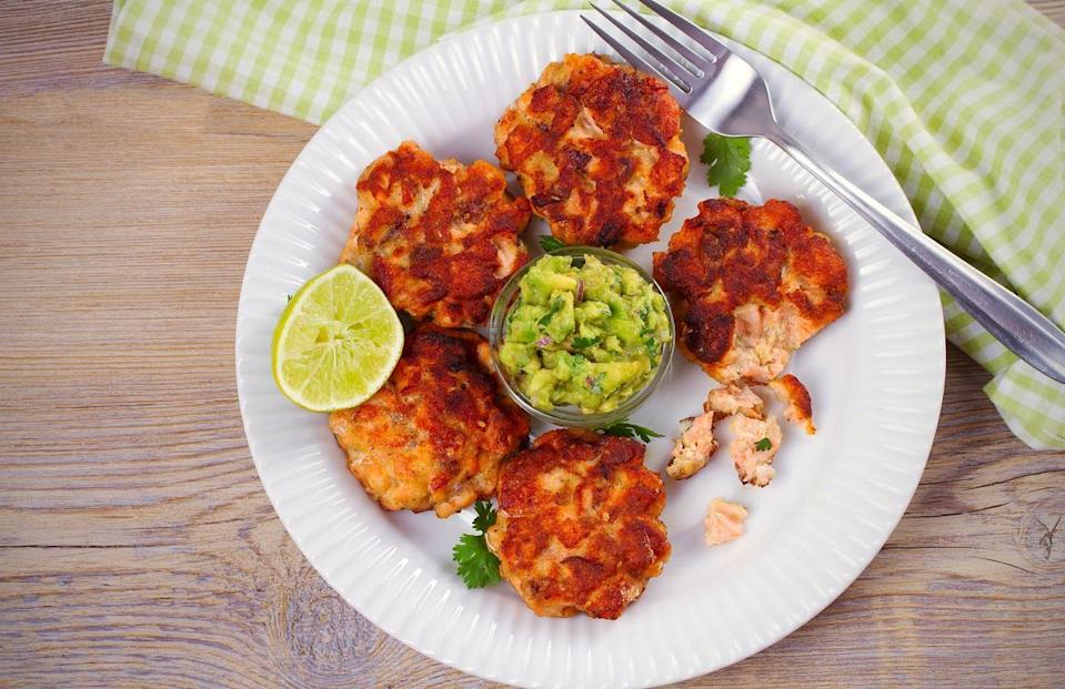 """<p>These salmon cakes <a href=""""https://www.thedailymeal.com/best-recipes/24-foolproof-seafood-recipes-anyone-can-cook-slideshow?referrer=yahoo&category=beauty_food&include_utm=1&utm_medium=referral&utm_source=yahoo&utm_campaign=feed"""" rel=""""nofollow noopener"""" target=""""_blank"""" data-ylk=""""slk:bring the flavor of your favorite seafood joint right to your kitchen"""" class=""""link rapid-noclick-resp"""">bring the flavor of your favorite seafood joint right to your kitchen</a>. Serve them on a toasted bun with some <a href=""""https://www.thedailymeal.com/recipes/guacamole?referrer=yahoo&category=beauty_food&include_utm=1&utm_medium=referral&utm_source=yahoo&utm_campaign=feed"""" rel=""""nofollow noopener"""" target=""""_blank"""" data-ylk=""""slk:guacamole"""" class=""""link rapid-noclick-resp"""">guacamole</a> and you've got a salmon cake sandwich in just 10 minutes.</p> <p><a href=""""https://www.thedailymeal.com/recipes/quick-easy-salmon-cakes-recipe?referrer=yahoo&category=beauty_food&include_utm=1&utm_medium=referral&utm_source=yahoo&utm_campaign=feed"""" rel=""""nofollow noopener"""" target=""""_blank"""" data-ylk=""""slk:For the Quick & Easy Salmon Cakes recipe, click here."""" class=""""link rapid-noclick-resp"""">For the Quick & Easy Salmon Cakes recipe, click here.</a></p>"""