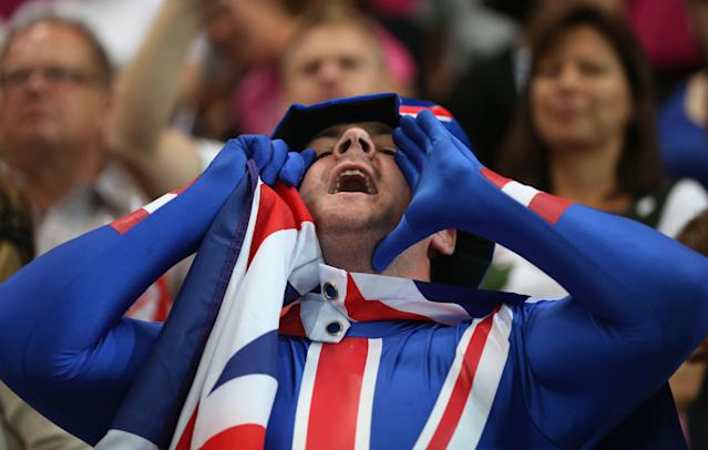 LONDON, ENGLAND - JULY 28: A Great Britain fan shows his support during the Women's Handball preliminaries Group A - Match 5 between Montenegro and Great Britain on Day 1 of the London 2012 Olympic Games at the Copper Box on July 28, 2012 in London, England. (Photo by Jeff Gross/Getty Images)