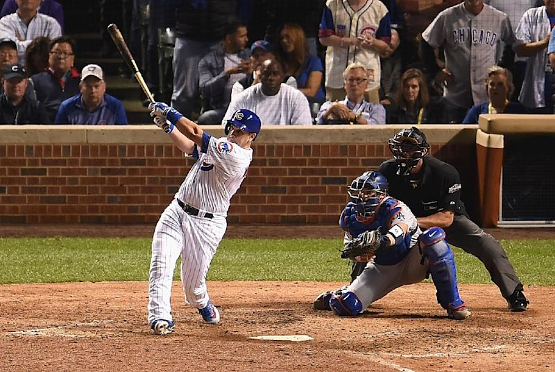 Miguel Montero of the Chicago Cubs hits a grand slam home run in the eighth inning against the Los Angeles Dodgers during game one of the National League Championship Series, at Wrigley Field in Chicago, Illinois, on October 15, 2016