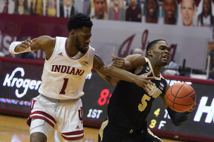 Purdue's Brandon Newman (5) is fouled by Indiana's Al Durham (1) during the first half of an NCAA college basketball game, Thursday, Jan. 14, 2021, in Bloomington Ind. (AP Photo/Darron Cummings)