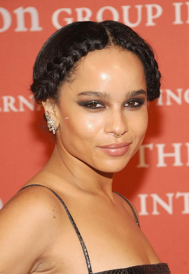 <p>The braids start at Kravitz's center part and flow outward, distinguishing it from the more circular crown braid. </p>