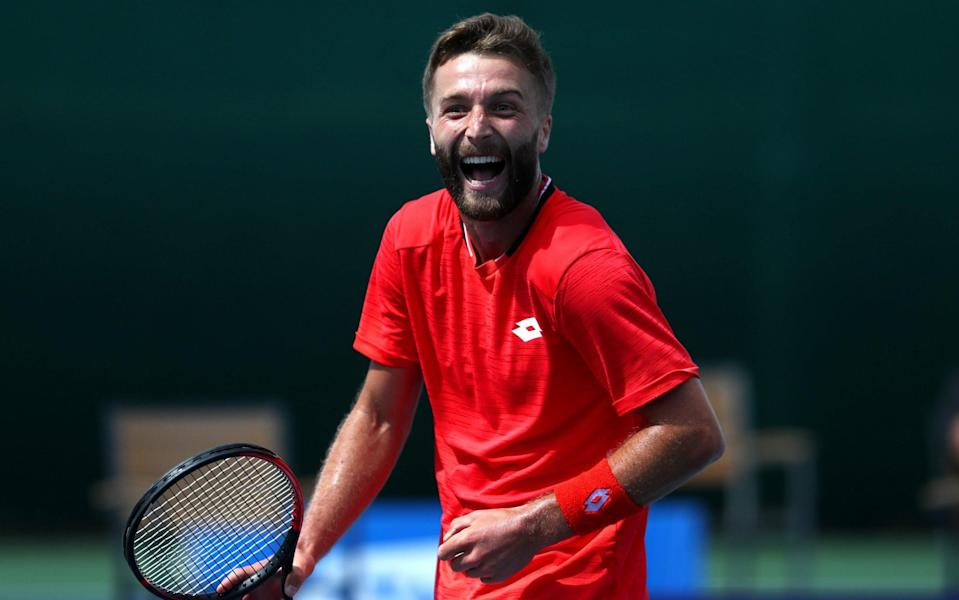 Liam Broady of British Bulldogs celebrates in his singles match against Ryan Peniston of Union Jacks during day seven of the St. James's Place Battle Of The Brits Team Tennis at National Tennis Centre - - GETTY IMAGES