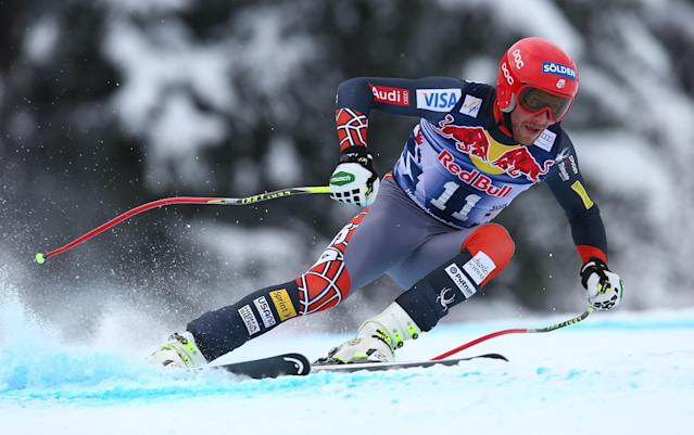 Bode Miller, of the United States, speeds down to the course during an alpine ski, men's World Cup downhill, in Kitzbuehel, Austria, Saturday, Jan. 25, 2014. (AP Photo/Alessandro Trovati)