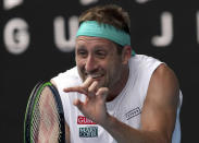 FILE - In this Jan. 28, 2020, file photo, Tennys Sandgren of the U.S. reacts after losing a point to Switzerland's Roger Federer during their quarterfinal match at the Australian Open tennis championship in Melbourne, Australia. Sandgren has reportedly been allowed on an Australia-bound flight despite recently testing positive for coronavirus. (AP Photo/Lee Jin-man, File)