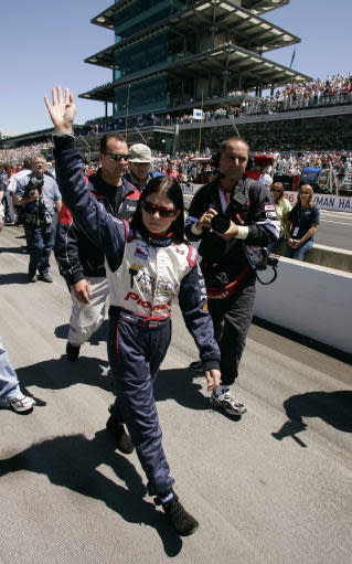 FILE - In this May 29, 2005, file photo, Danica Patrick waves to the crowd before the Indianapolis 500 auto race at Indianapolis Motor Speedway in Indianapolis. Patrick, who finished fourth in that race, is scheduled to compete in her final race this Sunday in the Indianapolis 500. (AP Photo/Michael Conroy, File)