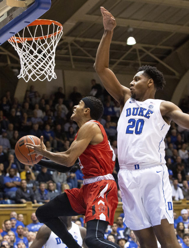 Hartford's J.R. Lynch (13) attempts a shot as Duke's Marques Bolden (20) defends during the first half of an NCAA college basketball game in Durham, N.C., Wednesday, Dec. 5, 2018. (AP Photo/Ben McKeown)