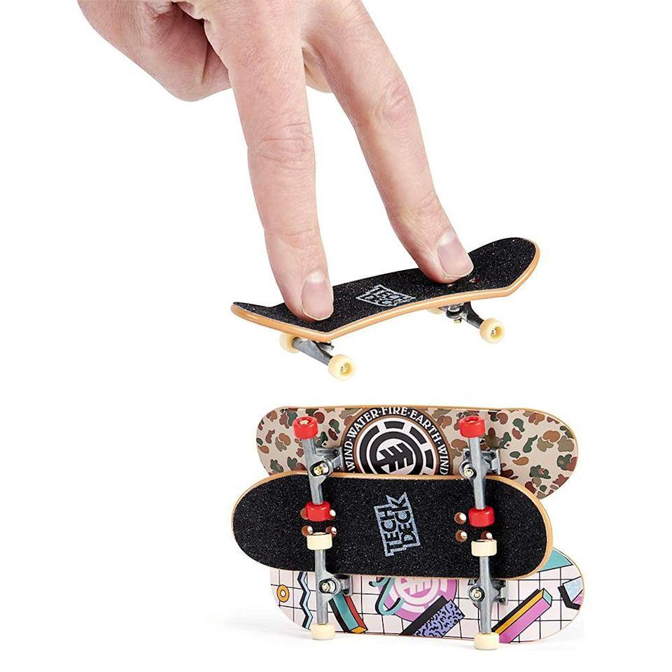 """<p><strong>TECH DECK</strong></p><p>amazon.com</p><p><strong>$10.99</strong></p><p><a href=""""https://www.amazon.com/dp/B08T64M74W?tag=syn-yahoo-20&ascsubtag=%5Bartid%7C2089.g.268%5Bsrc%7Cyahoo-us"""" rel=""""nofollow noopener"""" target=""""_blank"""" data-ylk=""""slk:Shop Now"""" class=""""link rapid-noclick-resp"""">Shop Now</a></p><p>Personally, as adults, we may have problems understanding the draw of finger skateboards, but trust us, kids love them. They slide them in their backpacks, keep them in their pockets, and play with and trade them with their friends. They're huge right now. </p>"""