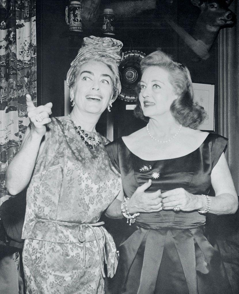 <p>Crawford and Davis are pictured at a party held to celebrate the premiere of <em>Whatever Happened to Baby Jane? </em></p>