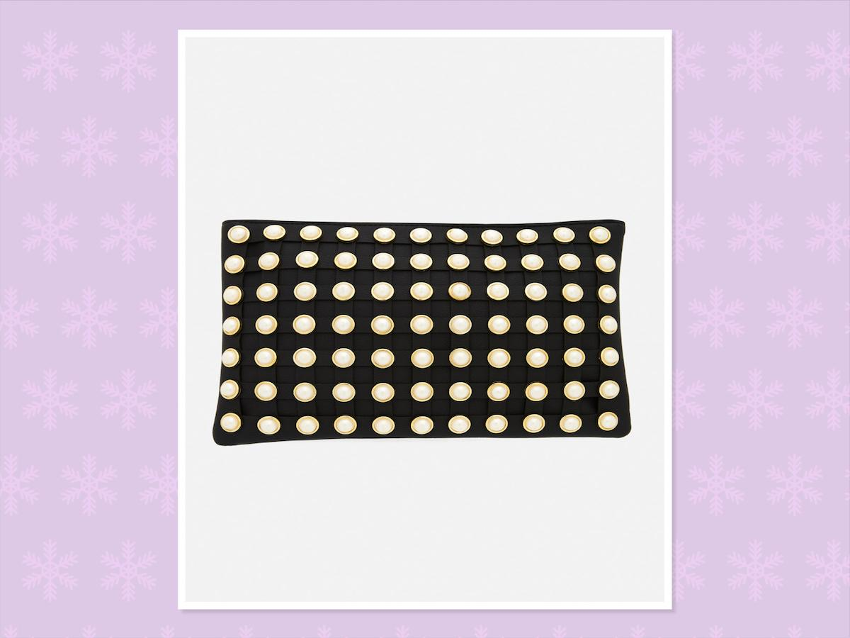 """<p>""""Bold earrings or clutches, like this pearl one, add extra glam to your holiday outfit and don't break the bank,"""" says Burkett.<br /><br />Sydney Pearl Clutch, $35, <a rel=""""nofollow"""" href=""""https://www.fashiontofigure.com/plus-size-pearl-clutch"""">Fashion To Figure</a>. You can find similar versions <a rel=""""nofollow"""" href=""""https://www.francescas.com/product/hillary-pearl-crossbody-clutch.do?gclid=EAIaIQobChMIsoSV16H71wIVFtVkCh1gAQxrEAYYASABEgKZ8_D_BwE&gclsrc=aw.ds"""">here</a> and <a rel=""""nofollow"""" href=""""http://us.boohoo.com/lily-pearl-stud-zip-top-clutch/DZZ46090.html?gclid=EAIaIQobChMI7-qZ8aH71wIVCLvsCh3z4wDsEAkYCiABEgKbZ_D_BwE&_%24ja=tsid%3A86460%7Ccid%3A765477555%7Cagid%3A41923226793%7Ctid%3Apla-169288823825%7Ccrid%3A183149408119%7Cnw%3Ag%7Crnd%3A16814507756104853619%7Cdvc%3Ac%7Cadp%3A1o10%7Cloc%3A9032154&gclsrc=aw.ds"""">here</a>. </p>"""