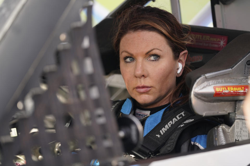Jennifer Jo Cobb prepares for NASCAR truck qualifying at Daytona International Speedway, Friday, Feb. 12, 2021, in Daytona Beach, Fla. (AP Photo/John Raoux)
