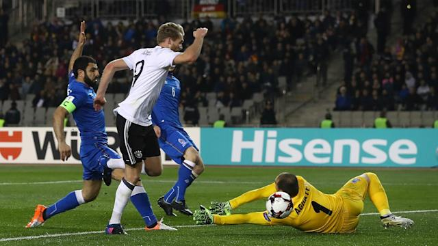 Andre Schurrle scored two and set up another against Azerbaijan as Germany made it five wins from five in World Cup qualifying Group C.