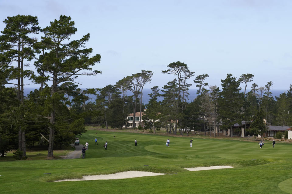 Jordan Spieth, third from right, hits his approach shot up to the sixth green of the Pebble Beach Golf Links during the second round of the AT&T Pebble Beach Pro-Am golf tournament Friday, Feb. 12, 2021, in Pebble Beach, Calif. (AP Photo/Eric Risberg)