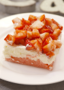 """<p>The doctored cake mix crust tastes like a cross between a blondie and a strawberry cookie—and makes your whole house smell amazing.</p><p>Get the recipe from <a href=""""https://www.delish.com/cooking/recipes/a46692/strawberry-cheesecake-bars-recipe/?visibilityoverride"""" rel=""""nofollow noopener"""" target=""""_blank"""" data-ylk=""""slk:Delish"""" class=""""link rapid-noclick-resp"""">Delish</a>.</p>"""