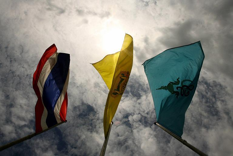 """Thai and Royal flags flutter in Bangkok. Police have banned a British journalist's book about politics for """"defaming"""" the monarchy, an official said"""