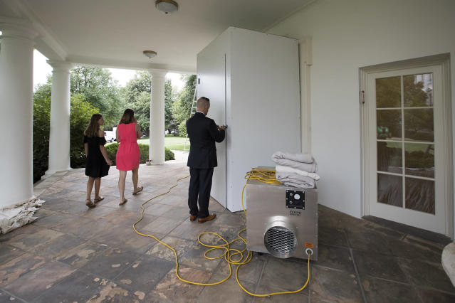 <p>A Secret Service agent unlocks a service entrance to the Oval Office as the West Wing of the White House in Washington, Friday, Aug. 11, 2017, as renovations continue while President Donald Trump is spending time at his golf resort in New Jersey. (AP Photo/J. Scott Applewhite) </p>