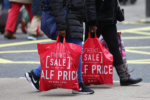 Shoppers with Next bags on Oxford Street, London, during the Boxing Day sales. (Photo: Isabel Infantes/PA Images via Getty Images)