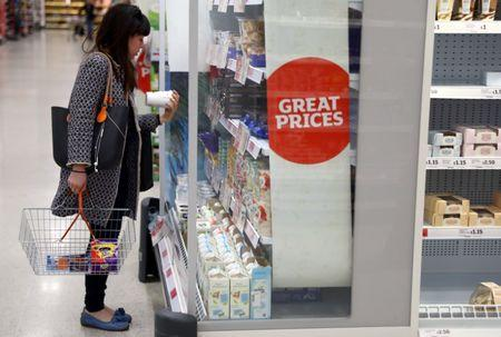 FILE PHOTO: A woman shops in a supermarket in London