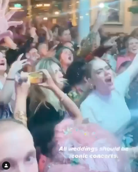 Blurry photo shows Adele singing in crowd to Florence Welsh at friend's wedding