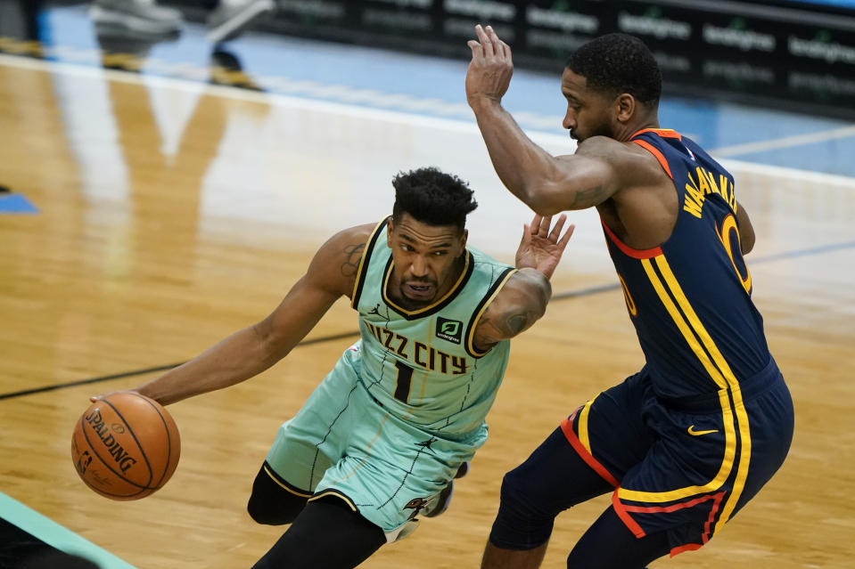 Charlotte Hornets guard Malik Monk (1) drives to the basket past Golden State Warriors guard Brad Wanamaker during the second half of an NBA basketball game on Saturday, Feb. 20, 2021, in Charlotte, N.C. (AP Photo/Chris Carlson)